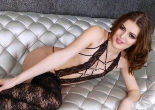 Fabulous tranny model in stockings masturbates in a solo shoot