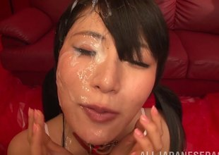 Cute Japanese face completely covered in cumshots