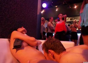 Gorgeous inked sluts getting naughty with a couple of men in a club