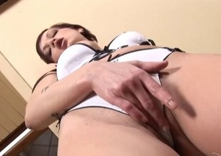 Short haired redhead masturbating with a massive dildo close up