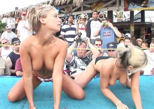 Seductive vixens show off their nice tits an asses at an erotic bikini party