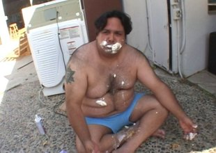 Chubby bloke has his cock milked in a messy food fetish clip