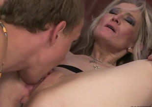 Golden-haired mature woman seduces fellow to fuck