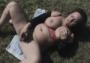 Fat old bitch uses a huge dildo to pound her aged wet crack outdoors