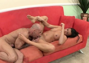 Skinny dark brown with perky tits uses her sensual feet to please