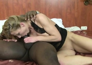 Older blonde slut satisfies her craving for a big black dick