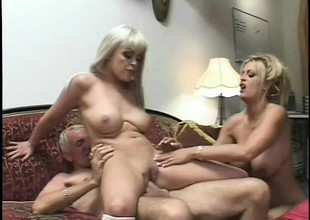 2 mesmerizing blondes with perfect boobs and butts share an older guy's cock