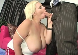 Naughty chubby slut gives a mean boob job with her gigantic boobs