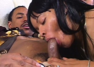 Ebon hottie with a big round ass and sexy tits sucks and copulates a huge black cock