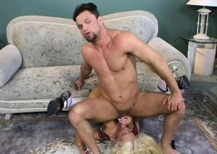 Stacked blond in white stockings gets pounded hard by two hung studs