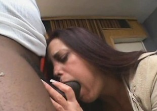 Gorgeous brunette girl gets a smack of a giant dark schlong