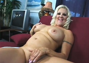 Big breasted blonde mom Veronica Vaughn is in need of a stiff cock deep in her cum-hole