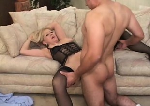 Breasty blonde cougar in darksome lingerie takes a young cock for a ride
