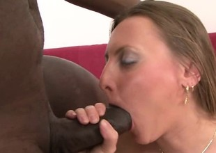 Thick white MILF gets her pussy stirred by a massive dark cock