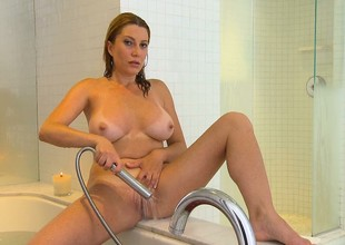 Hot, busty Milf is in the shower and using fingers and water wand on her cunt