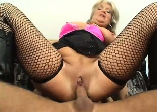 This granny likes them young she uses her big tits to suck his cock