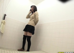 Asian ho pisses in water closet