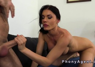 Busty amateur gags big cock in casting
