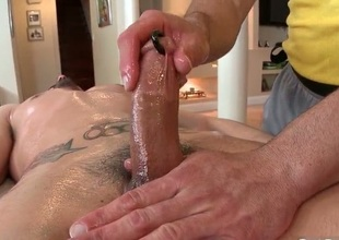 Dude receives his biggest pierced dick massaged