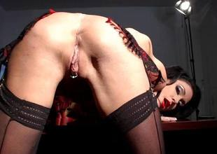 Horny brunette hair Jessica Jaymes fingers her sweet love tunnel pie in her office