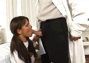 Sexy brunette babe sucks the doctors hard dick