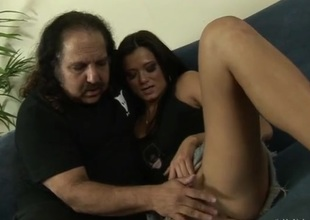 Ron Jeremy watches a slim cutie get undressed for him