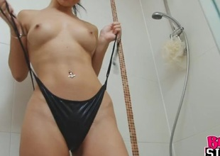 Shiny bikini on a babe getting soapy in the shower