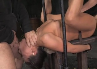 Asian in steel bondage fucked by two guys
