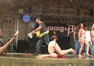 Chicks at a biker show dance on stage