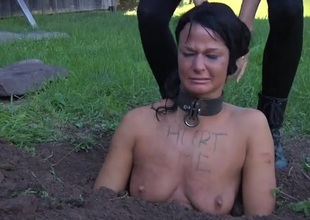 Collared girl buried in the dirt and humiliated