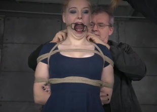 Rope bound girl with small melons takes a whipping