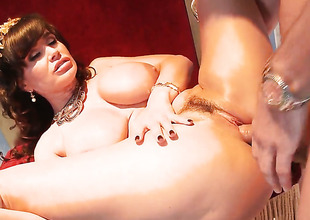 Lisa Ann with juicy breasts loves her Mick Blues ram rod in this anal scene
