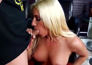 Blonde pornstars is in her stockings. She is in front of a stud and she's sucking his dick. She does it really skillfully. The man enjoys her company.
