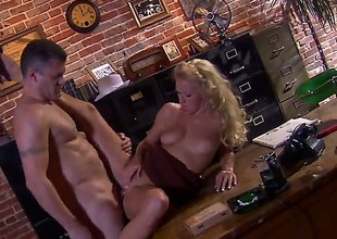 Chap in hat Randy Spears has unforgettable sex in office with beautiful blonde Cassie Young. She eats his hard dick with appetite and then gets her neatly trimmed pussy royally fucked.