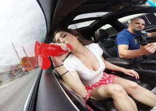 This lewd as fuck sexy with long legs and a large arse put on the car side window one of her homemade sex toys and she is making a great use of that thingy