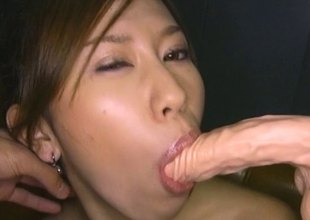 Guy coats an Asian hotty in messy oil and toys her cunt