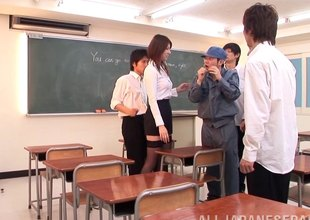 Red hot Asian teacher keeps students after class to fuck