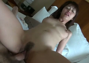 Skinny hot and kinky Asian doxy takes fat prick in her trained cunt
