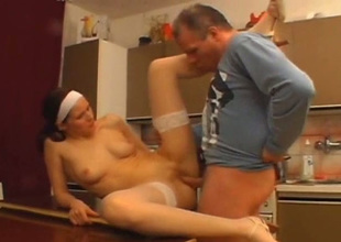 Spoiled nympho in white stockings gets fucked on the dining table