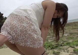 Nasty Japanese cutie Mayuka Akimoto gives blowjob on the beach