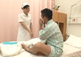 Japanese brunette nurse gives her patient astonishing cook jerking