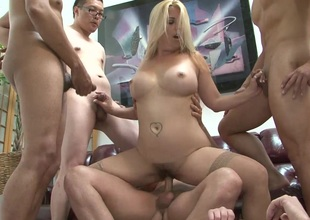 Tattooed cowgirl with big tits acquires her slit gangbanged in hot group sex