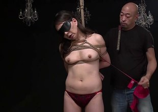 Asian slave has her tits tied with rope while he bonks her