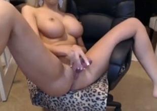Pretty blonde bimbo with plump lips and fake tits