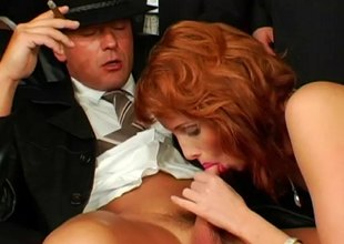 Buxom redhead has her face coated in nut butter at a hardcore gang bang action