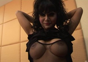Wavy haired brunette in fishnets milks a stiff cock for cum in pov