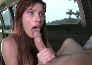 Hot redhead chick Annie  copulates her new fellow in his car