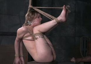 Golden-haired strumpet Mercy West is duct taped and tied up