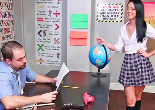 Innocent schoolgirl is bored at detention in this scene.