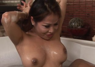 A guy is getting licked by an Asian chick in the bathroom